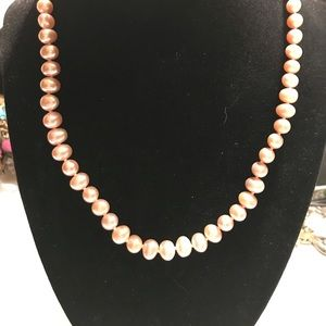 "Strand of 18-20"" pearls"